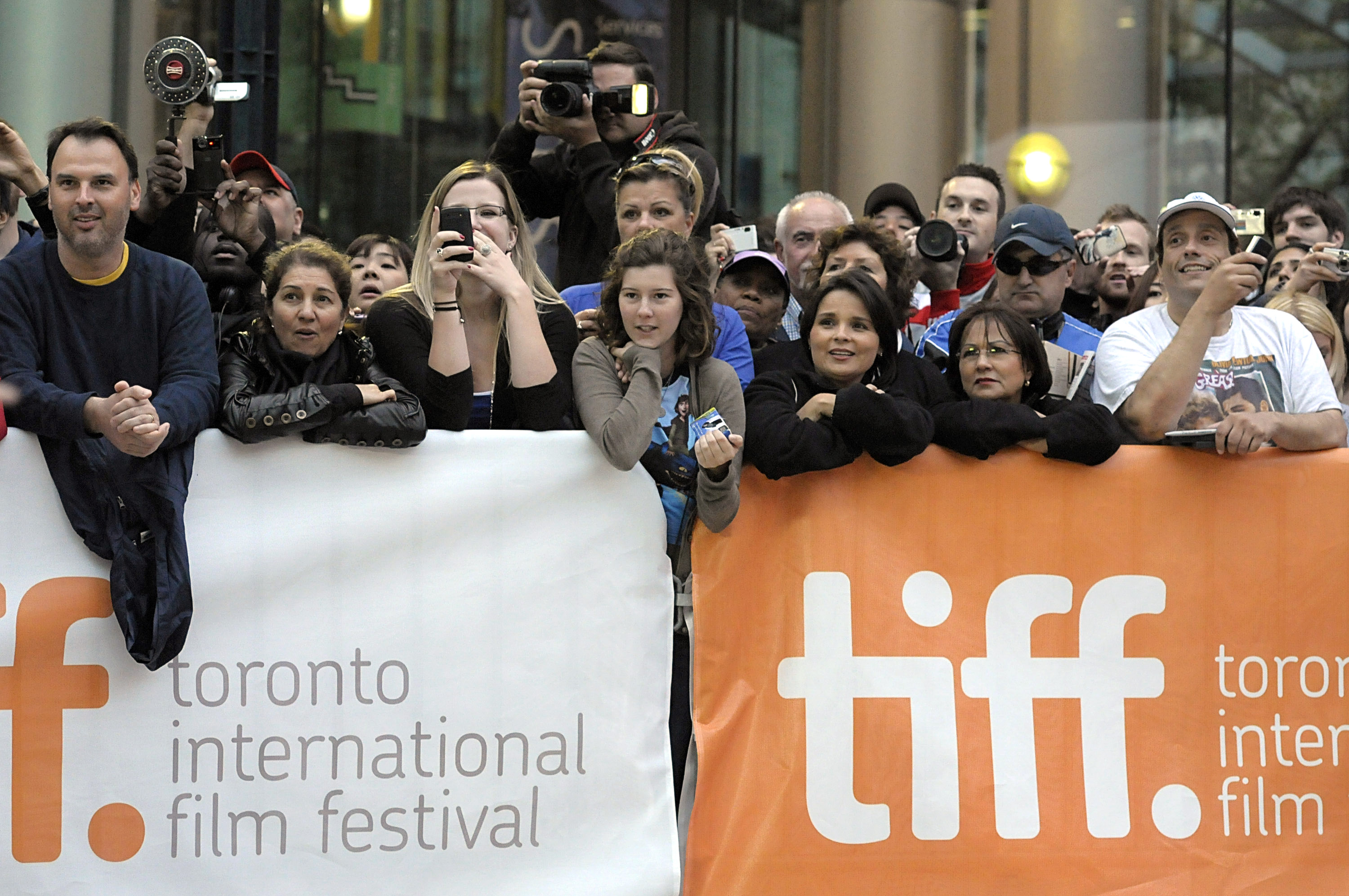 Fans watch as celebrities arrive at the Toronto International Film Festival opening night premiere of the feature film 'Score: A Hockey Musical' in To...
