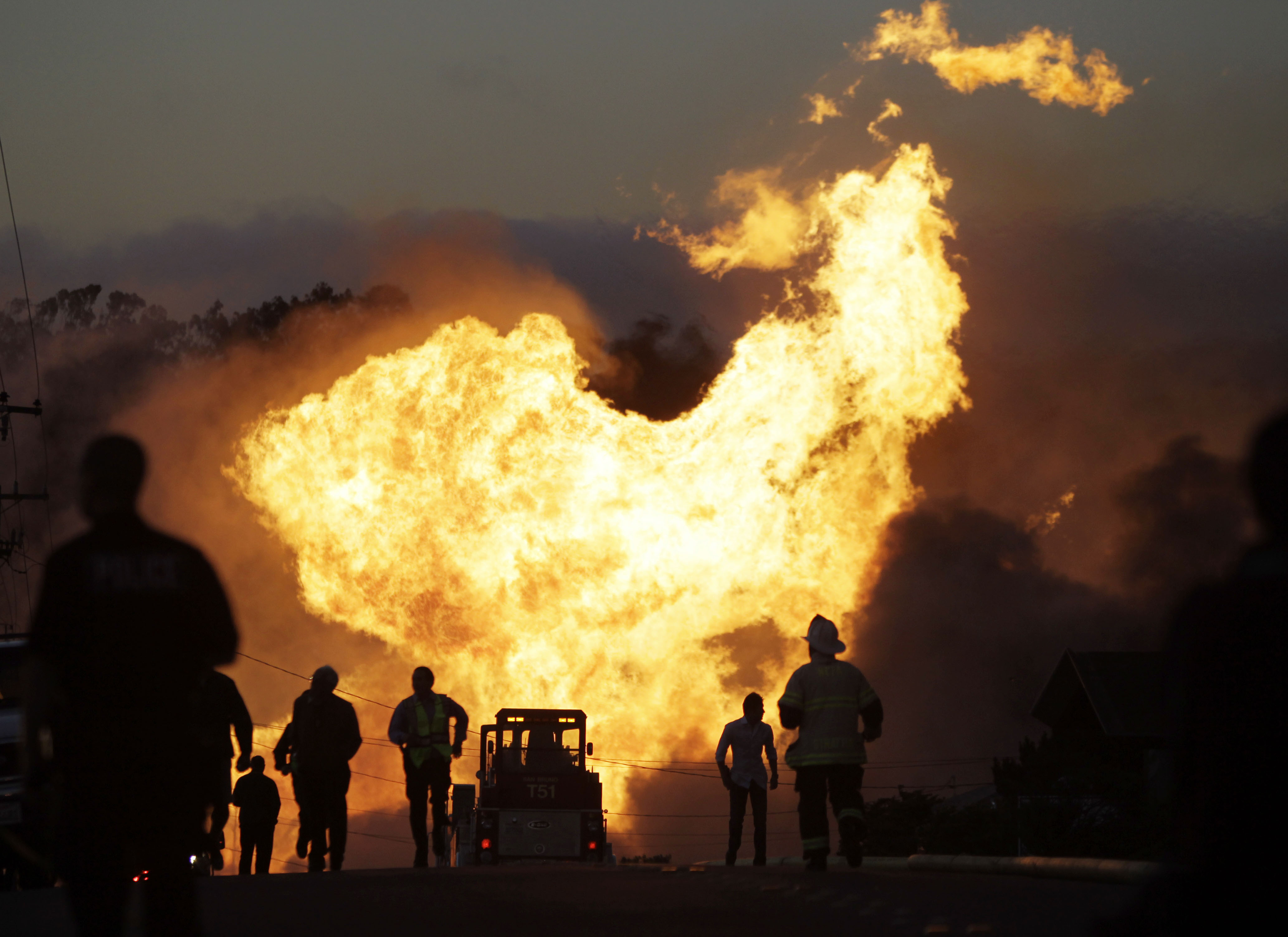 A massive fire roars through a mostly residential neighborhood in San Bruno, California on Thursday.