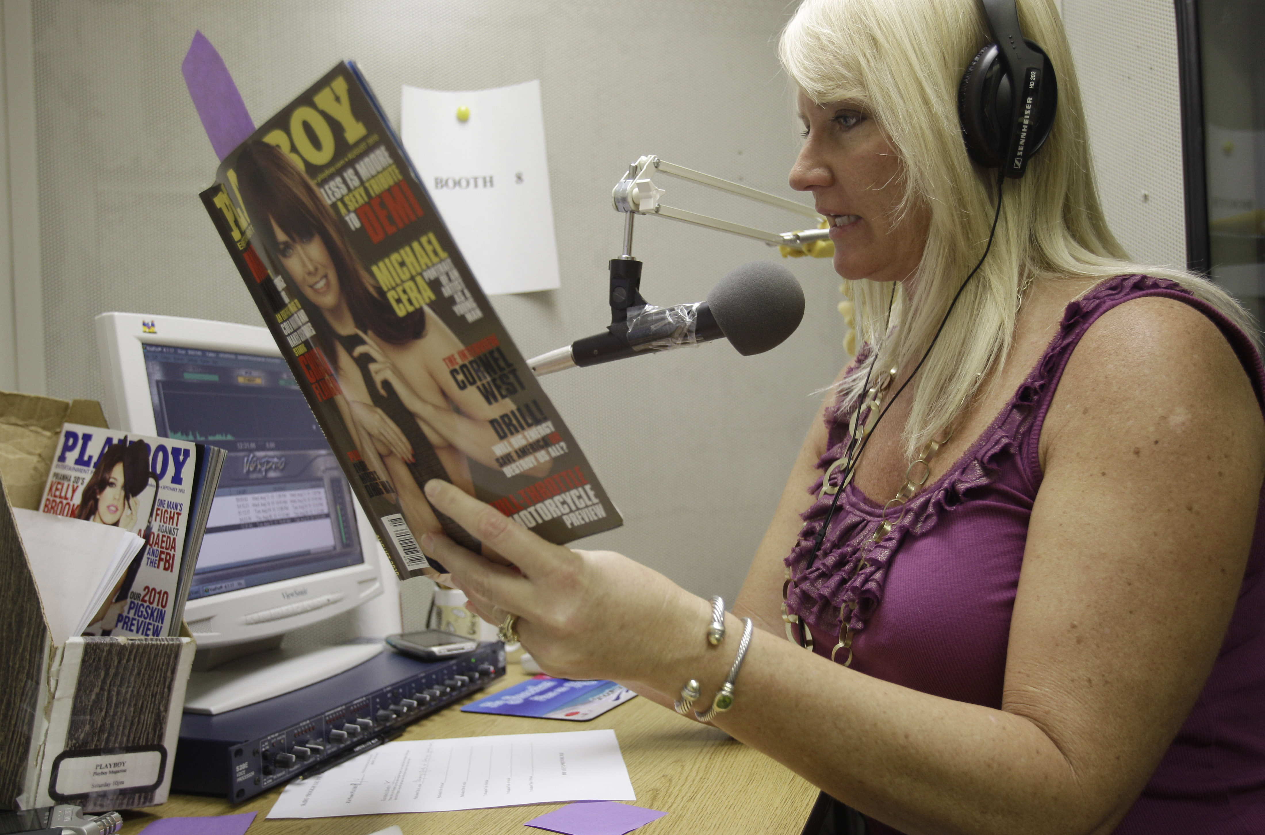 Suzi Hanks sits in a tiny sound booth demonstrating how she describes a Playboy magazine photo, just before she spends her weekly hour reading the mag...