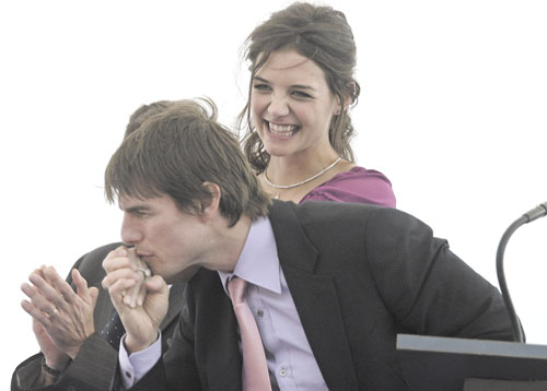 Tom Cruise, foreground, and Katie Holmes, shown in this file photo, have yet to release a photo of their baby, Suri.