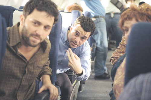 """Passengers plot their retaliation against the hijackers in a scene from Paul Greengrass' """"United 93."""""""