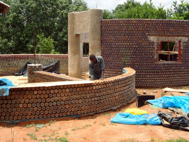 A man builds a wall with plastic bottles in the village of Sabon Yelwa. A group of activists have come up with a plan to build a house using bottles, ...