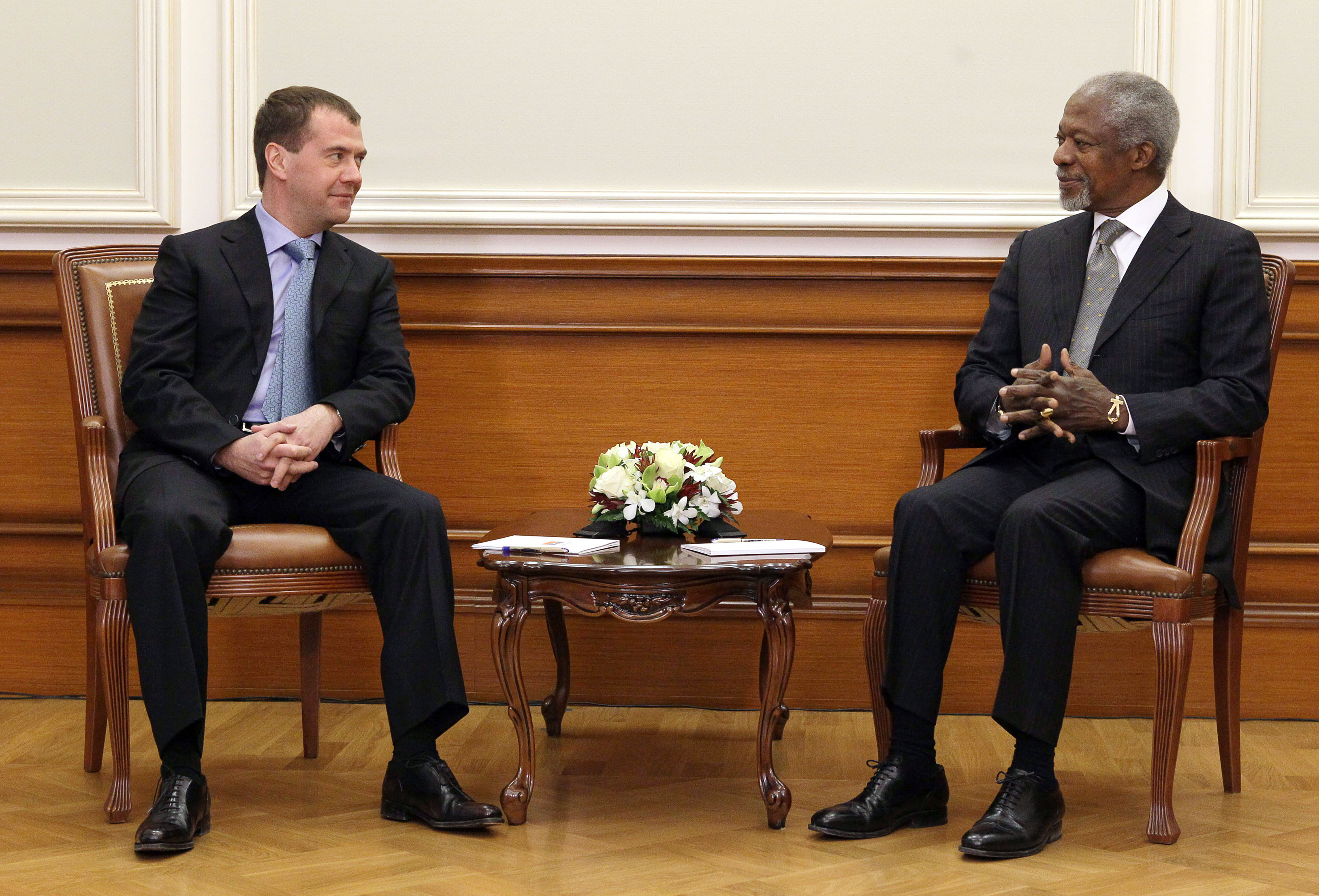 Russia's outgoing President Dmitry Medvedev (L) speaks with United Nations, Arab League envoy to Syria, Kofi Annan, during their meeting in Moscow, on...