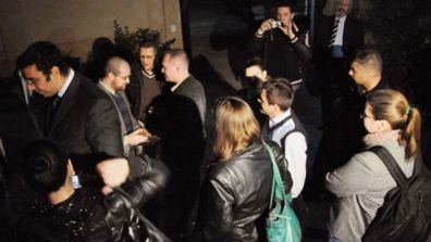 December 29, 2011: Workers from a non-governmental organization National Democratic Institute, or NDI, wait as Egyptian officials raid their office in...