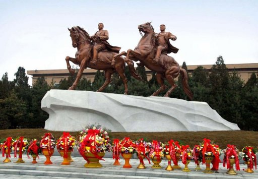 Statues of former North Korea founding father Kim Il-Sung (L) and late leader Kim Jong-Il in Pyongyang (AFP/KCNA via KNS)