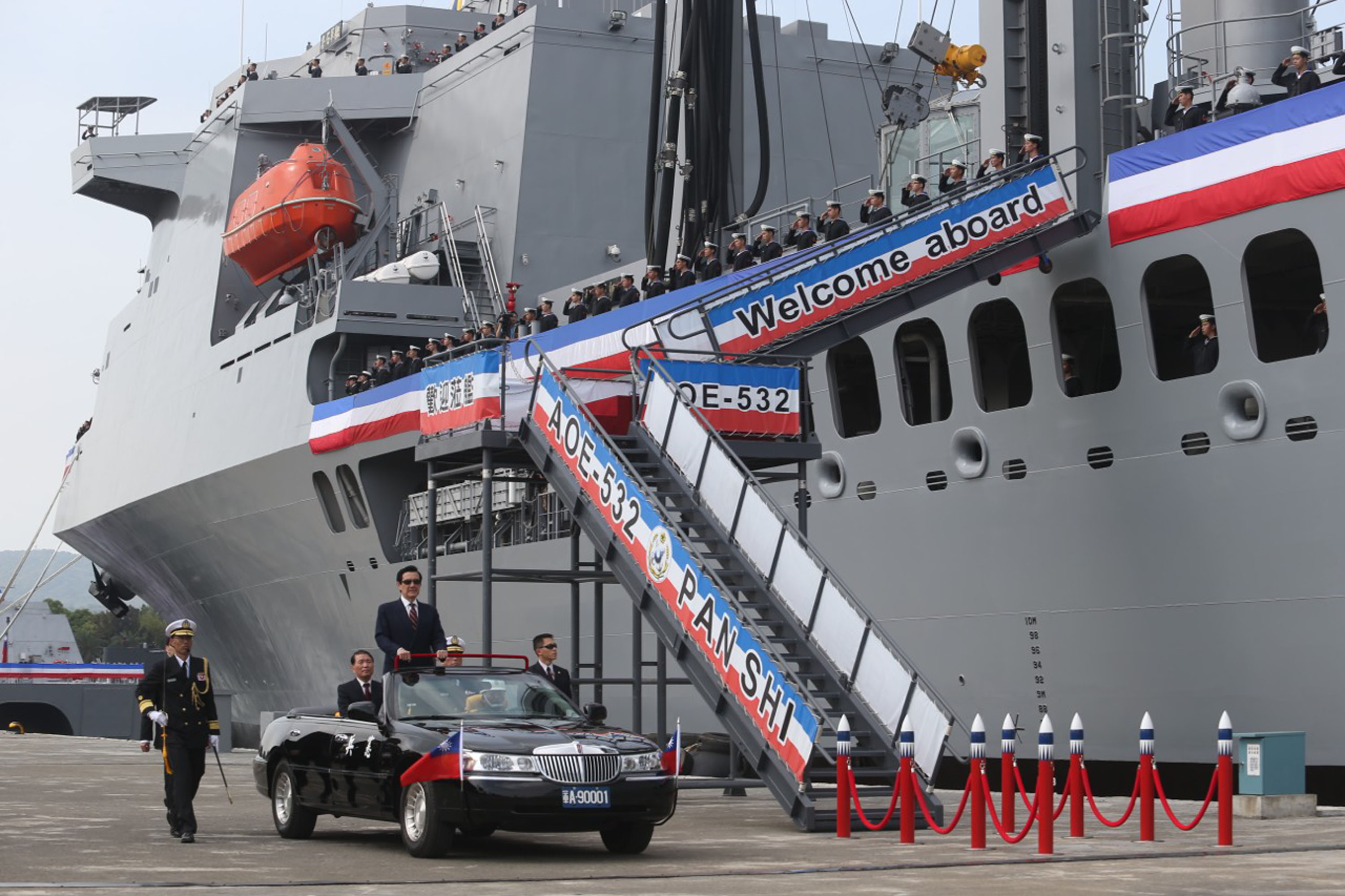 President attends ceremony commissioning military vessels (update)