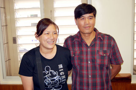 file photo of 2011: Ku Chin-shui (right) and his wife