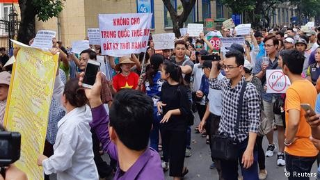 China issues warning to citizens after Vietnam protests over economic zones