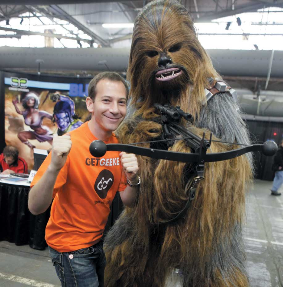 Gareb Shamus, CEO of Wizard Universe, poses with a Wookie character from 'Star Wars' at the Big Apple Comic Con in New York, New York on Friday. This ...