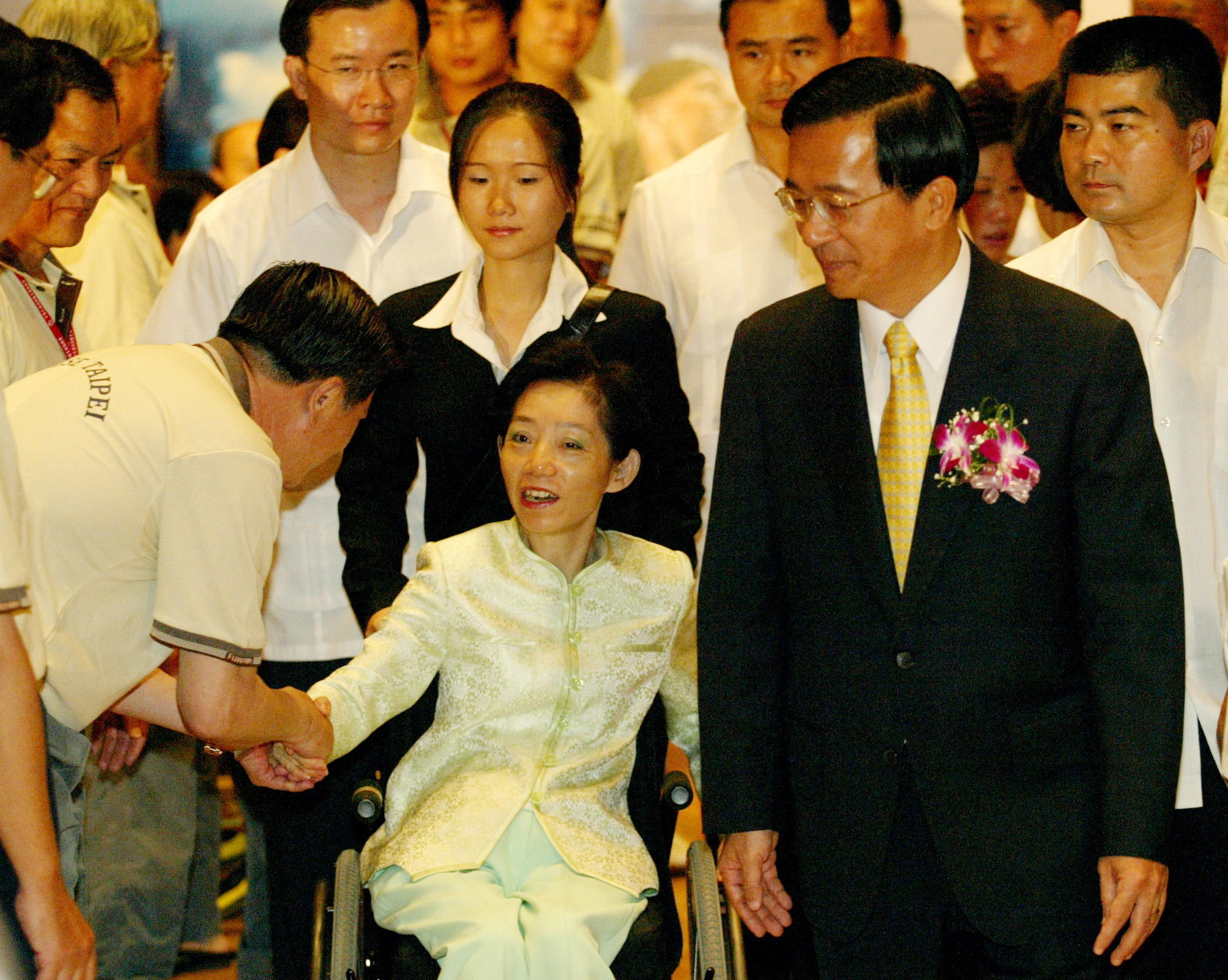 President Chen Shui-bian (R) and first lady Wu Shu-jen attend the flag-presenting ceremony of 2005 International Wheelchair and Amputee Games in Taipe...
