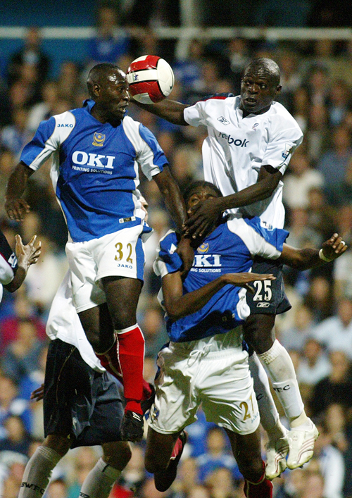 Portsmouth's Lomana Tresor LuaLua, left, jumps to head the ball with the Bolton Wanderers' Abdoulaye Faye during their English Premier League soccer m...