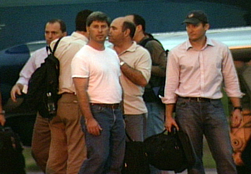 American airplane pilots Joseph Lepore (left, white T-shirt) and Jean Paul Palladino (right) wait for a commercial flight in the airport of Cuiaba, so...