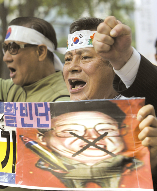 Protesters shout slogans at a rally denouncing North Korea in Seoul, South Korea yesterday.
