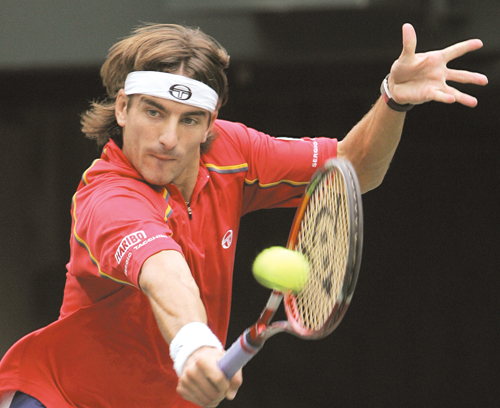 Tommy Robredo of Spain returns the ball against Lu Yen-Hsun of Taiwan during the second round of the Japan Open Tennis Championships at Ariake tennis ...
