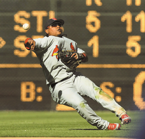 St. Louis Cardinals second baseman Ronnie Belliard throws to retire San Diego Padres' Todd Walker to end the seventh inning with the bases loaded duri...