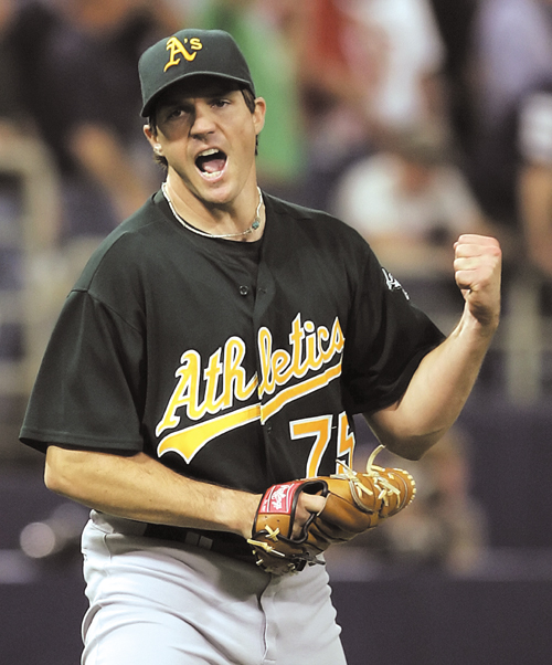Oakland Athletics starting pitcher Barry Zito reacts to retiring Minnesota Twins batter Joe Mauer to end the eighth inning of Game 1 of the American L...