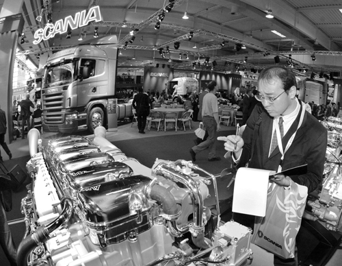 A visitor looks at a Scania engine at the IAA Commercial Vehicles Show in Hanover, Germany on September 20, 2006. Scania rejected a takeover bid by MA...