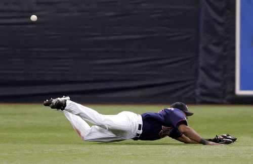 Minnesota Twins center fielder Torii Hunter dives but fails to catch a ball in Game 2 of the American League Divisional Series playoff baseball game i...