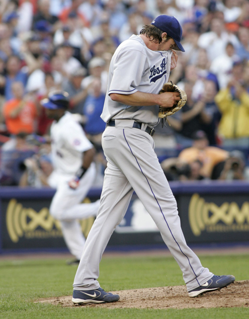 Los Angeles Dodgers pitcher Derek Lowe reacts as New York Mets Cliff Floyd, left, rounds the bases after hitting a solo home run in their National Lea...