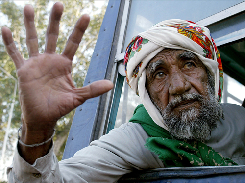 A Pakistani prisoner, Ramdan, 60, waves before crossing the Wagah border on the outskirts of the northern Indian city of Amritsar on Friday.