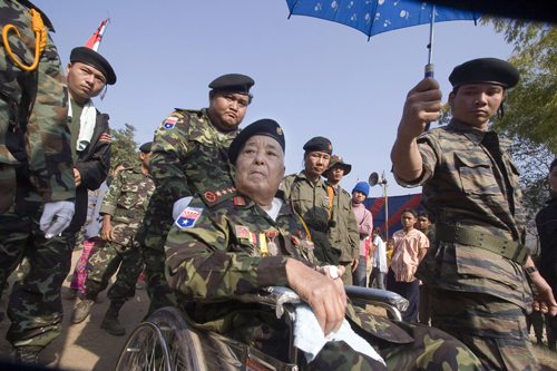 Karen National Army General Bo Mya is wheeled away in this January 31 file photo.