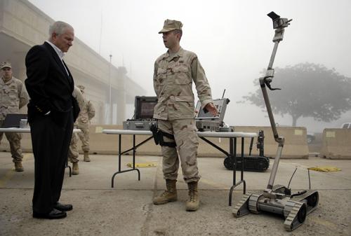 In this image released by the U.S. Department of Defense, U.S. Defense Secretary Robert Gates, left, speaks with U.S. Air Force Senior Airman Paul Wil...