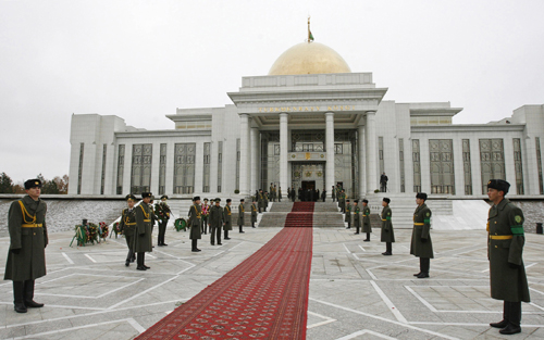Soldiers stand guard in front of the grand palace where the body of Turkmenistan's president Saparmurat Niyazov is on display in Ashgabat, Turkmenista...