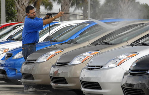 A car dealer washes a Toyota Prius hybrid at Maroone Toyota in Weston, Florida last week. Toyota Motor Corp. may end General Motors Corp.'s 81-year re...