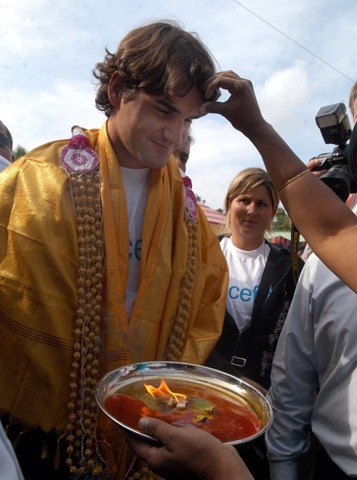 Tennis player and UNICEF Goodwill Ambassador Roger Federer is welcomed in a traditional way on his visit to Thazzhanguda village 165 kilometers south ...