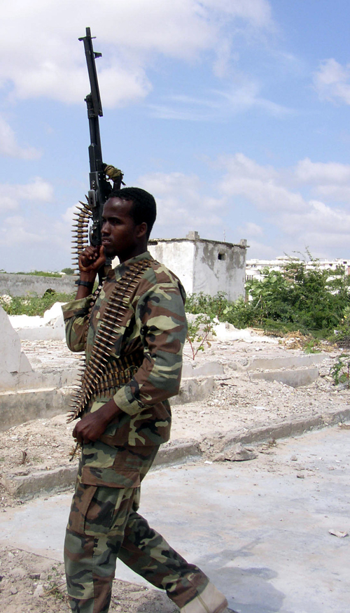 An Islamic Courts soldier patrols Mogadishu airport yesterday.