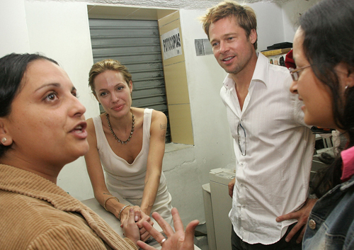 Goodwill Ambassador Angelina Jolie, center, and actor Brad Pitt, right, meet with a Colombian refugee family in San Jose, Costa Rica yesterday.
