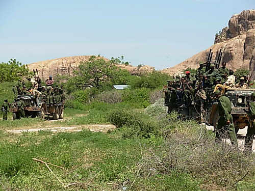 Transitional Federal Government soldiers position themselves on trucks in Burhakaba in Somalia on Tuesday.