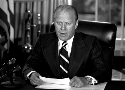 """U.S. President Gerald Ford tells newsmen in his White House office that he has granted former President Richard M. Nixon """"a full, free and absolute pa..."""
