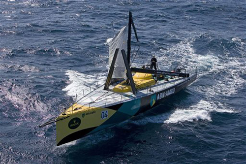 In this photo released by Rolex, Dutch yacht ABN Amro using a jury rig limps back toward Sydney after she lost he most in the early morning hours of y...
