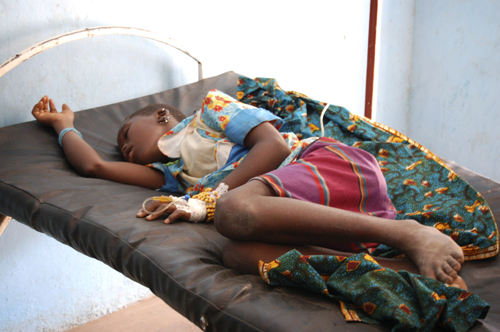 Twelve-year-old Diarra lies unconscious on a hospital bed suffering from classic meningitis symptoms: fever, stiffness and vomiting in Senegal's capit...