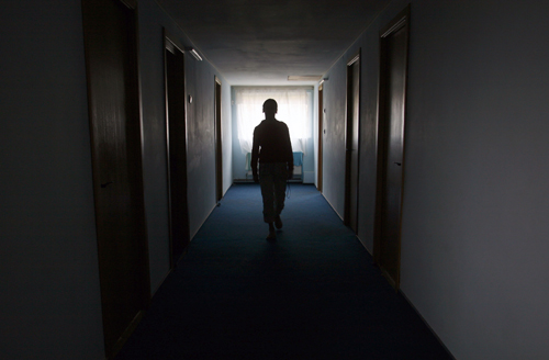 A former Romanian sex slave walks in a shelter in Romania in this November 30, 2006 file picture.