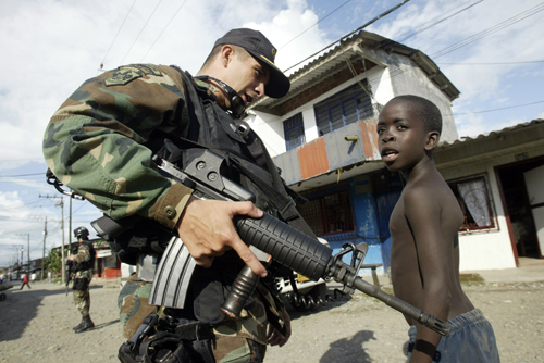A navy soldier speaks with a boy on a street of Antonio Lleras slum of Buenaventura Pacific Port, Colombia on November 7.