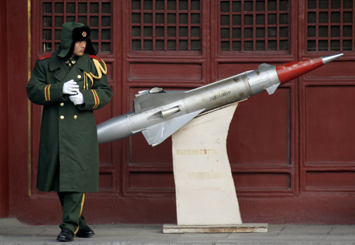 A soldier stands beside a missile model inside the Forbidden City in Beijing, China yesterday.