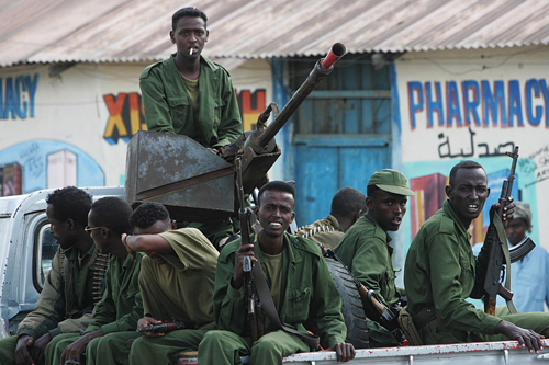 Transitional Federal Government soldiers ride in a truck in Bur Haqaba, 60 kilometers south of Baidoa, Somalia on Thursday.