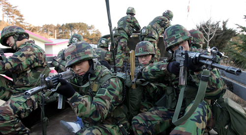 South Korean soldiers aim their machine guns near the demilitarized zone in YangYang, east of Seoul, South Korea yesterday.
