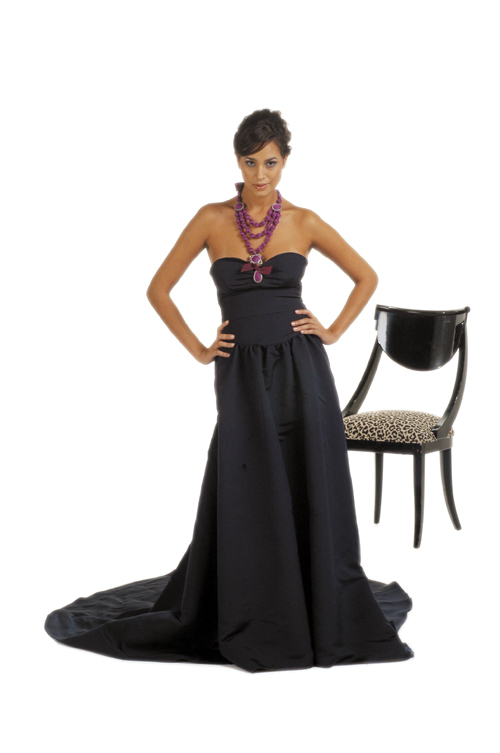 A model wears a black evening dress by This strapless navy gown by Peter Som is good choice for a formal New Year's Eve party.Gucci.