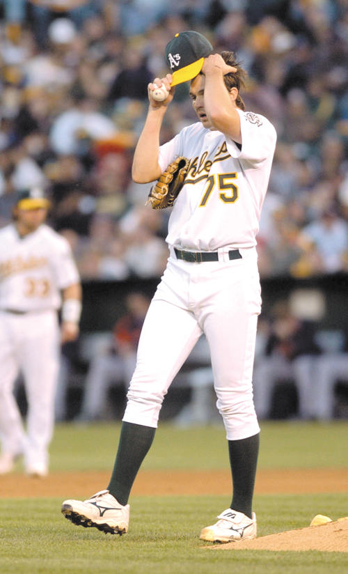 Oakland Athletics starter Barry Zito wipes his brow during Game 1 of the American League Championship Series against the Detroit Tigers at McAfee Coli...