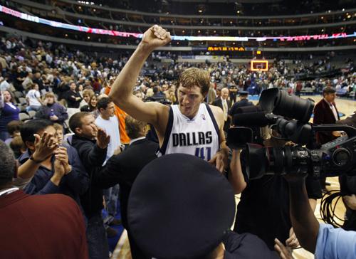 Dallas Mavericks' Dirk Nowitzki celebrates after Thursday's game.