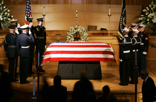 Members of the Honor Guard salute as they change positions while former President Gerald R. Ford lies in repose on Friday in Palm Desert, California.