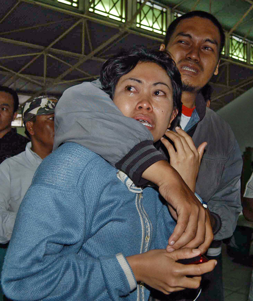 Relatives of victims of a sunken ferry wait for news in Semarang, Indonesia yesterday.