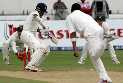 India's batsman Sourav Ganguly, left, takes evasive action against a bouncer from South Africa's bowler Makhaya Ntini, right, during their second inni...