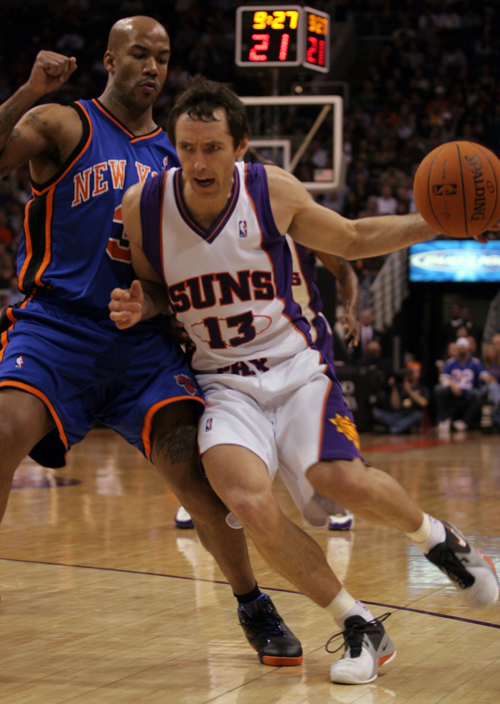 Phoenix Suns guard Steve Nash, right, drives on the New York Knicks' Stephon Marbury, during the first quarter of their NBA basketball game in Phoenix...