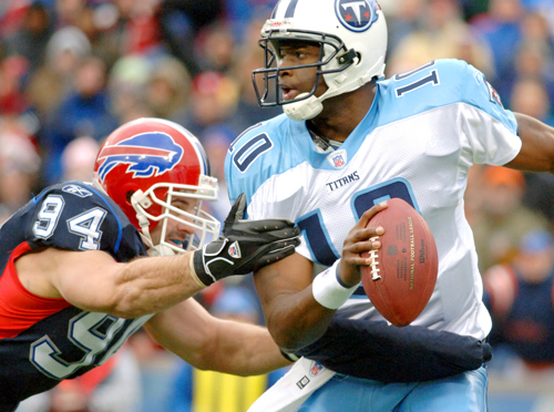 Tennessee Titans quarterback Vince Young, right, escapes from being sacked by Buffalo Bills defensive end Aaron Schobel during their game last Sunday....