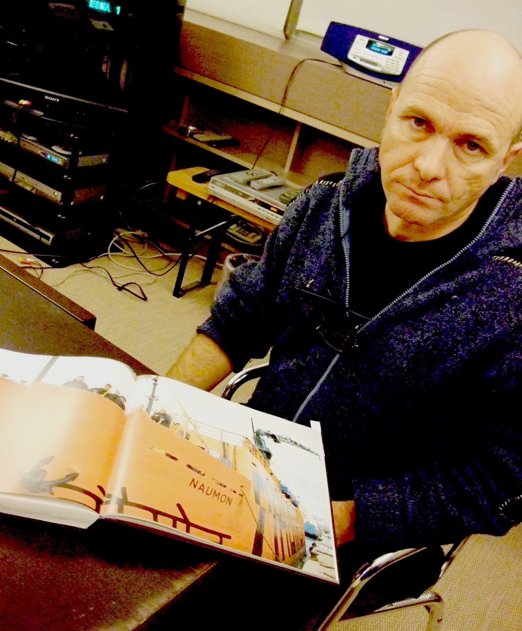 """Carlus Padrissa of La Fura dels Baus shows a book with a picture of the ship """"Naumon."""""""