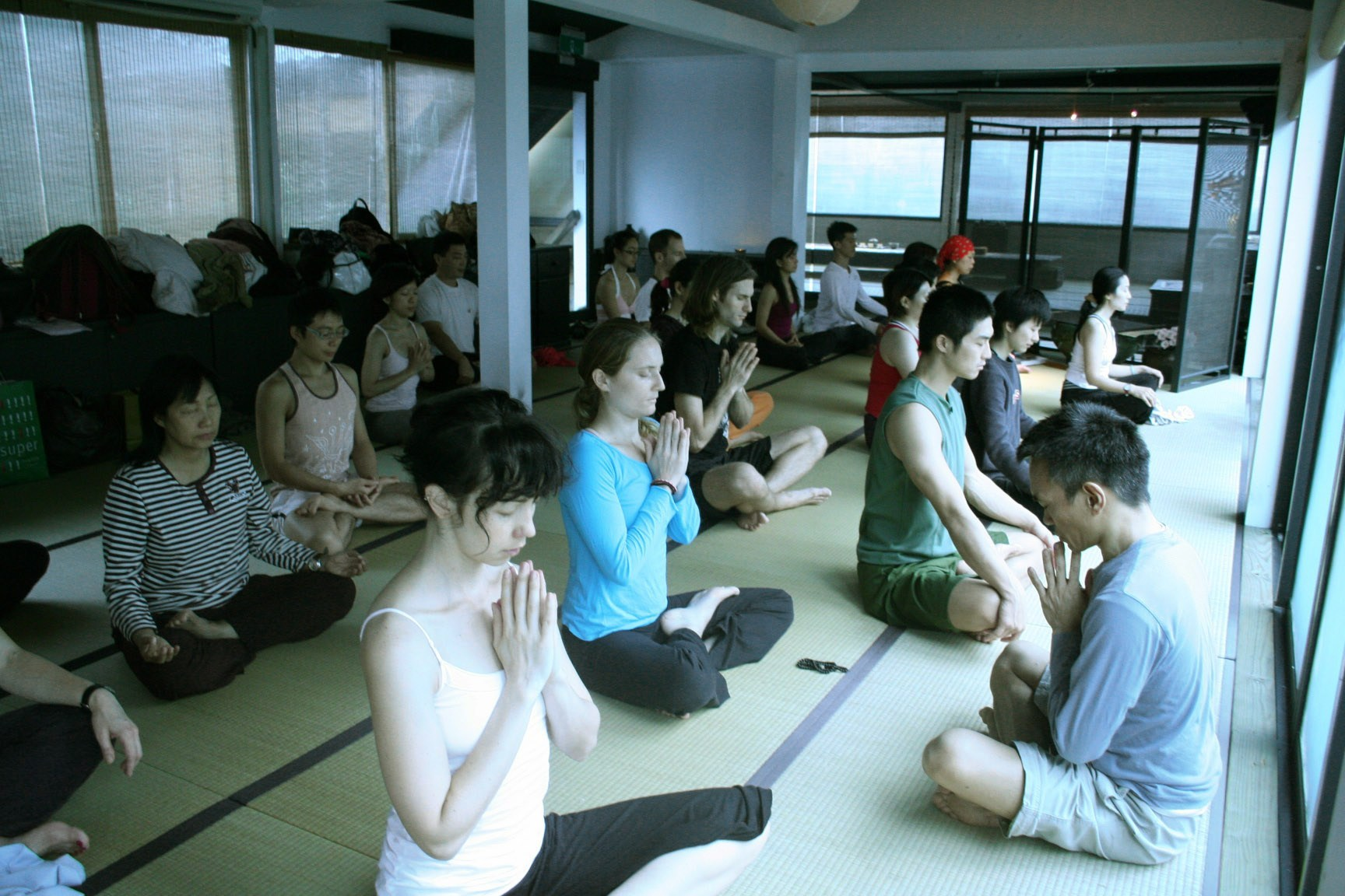 Ang takes yoga students up to Yangmingshan for a session with tabla and sitar musicians playing music to provide a good ambience.